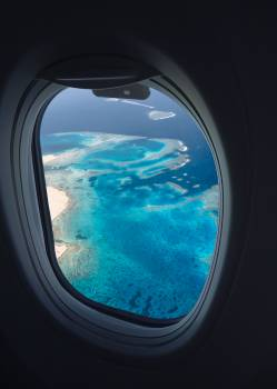 Body of Water View from Airplane Window Free Photo