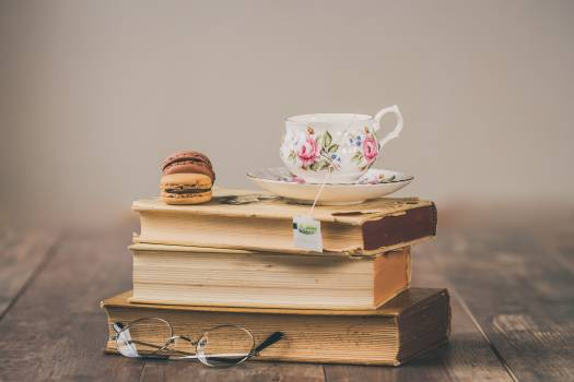 Photo of Teacup On Top Of Books #338247