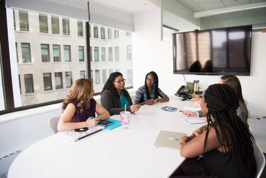 Group of Five Women Gathering Inside Office Free Photo