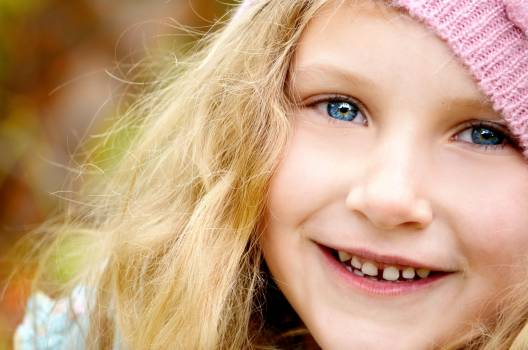 Blond Haired Girl Wearing Pink Knitted Cap #33840