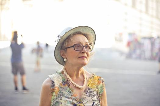 Depth of Field Photography of Woman in Pastel Color Sleeveless Shirt and White Sunhat Free Photo