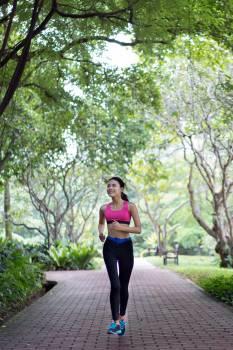 Woman Running On Pathway #338427