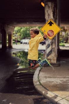 Boy Jumping from Road Curb Free Photo