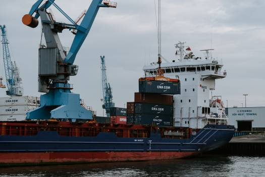 Blue and Red Cargo Ship With Crane Free Photo