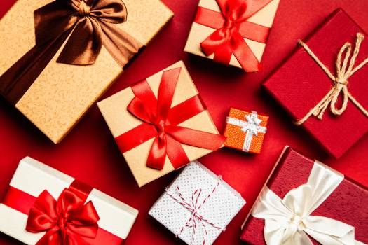 Assorted Gift Boxes on Red Surface Free Photo