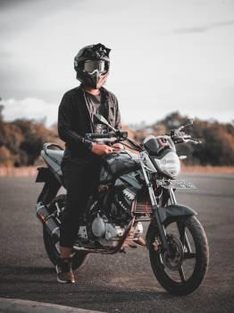Man Riding Gray Backbone Motorcycle Free Photo
