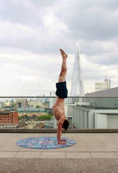 Man in Blue Shorts Tumble Upside Down Free Photo