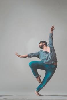 Dancing Man Wearing Pants and Long-sleeved Shirt Free Photo