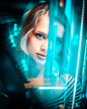 Photo of Woman's Face in Front of Neon Light Free Photo