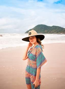 Photo of Woman Standing On Seashore #339500