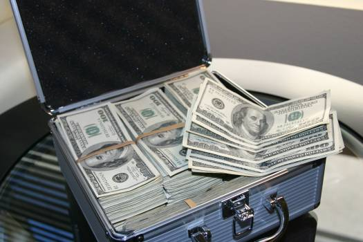 Piles of U.s. Dollar Bills on Silver and White Suitcase Free Photo