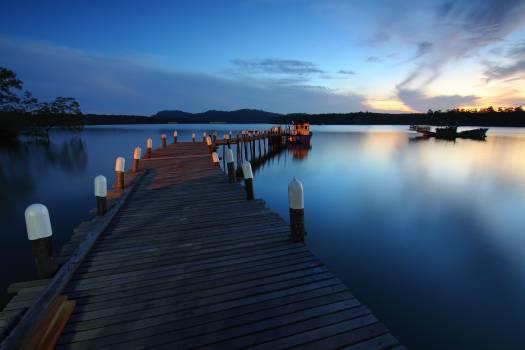 Boat calm waters dawn dock Free Photo