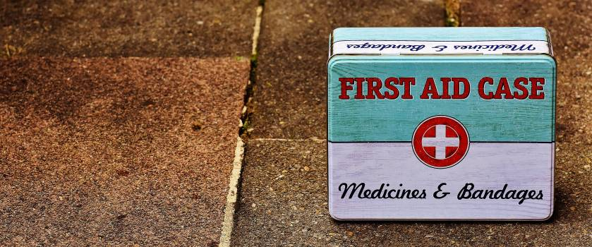 First Aid Case on Brown Floor Surface Free Photo