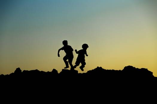 Silhouette Photo of Jumping Children Free Photo