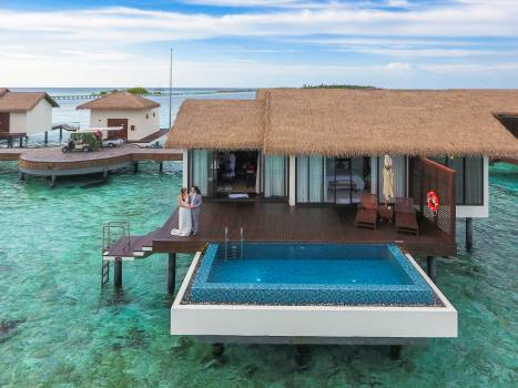 Couple Standing at Maldives Cottage Free Photo