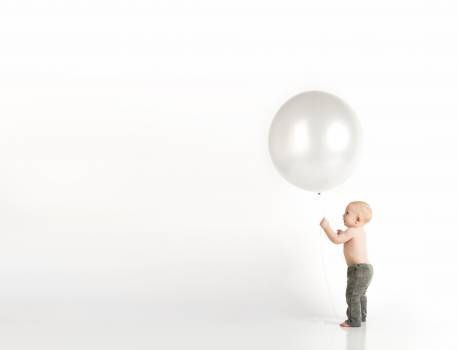 Baby in Black Pants Holding White Balloon While Standing #340113