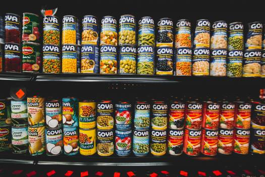 Labeled Can Lot on shelves Free Photo