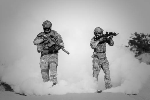 Two Men in Military Clothing With Guns Free Photo