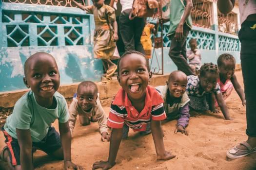 Children Sitting on Ground Free Photo