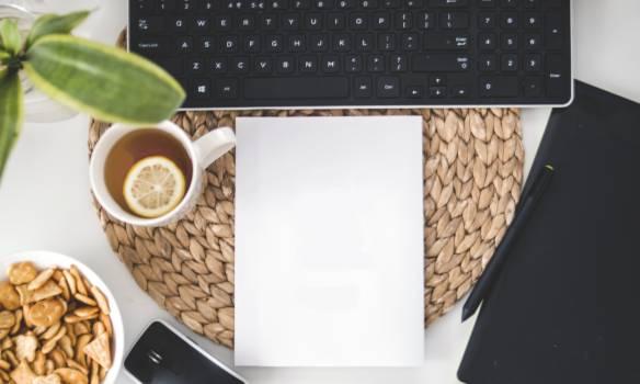 White Printing Paper Near Black Computer Keyboard Free Photo