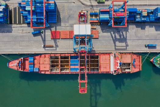 Aerial Photo of Cargo Ship Near Intermodal Containers Free Photo