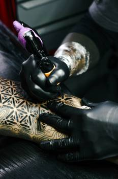 Selective Focus Photography of Tattoo Artist Drawing A Tatoo #340431