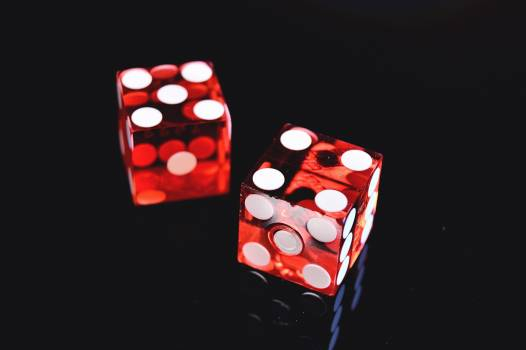 Closeup Photo of Two Red Dices Showing 4 and 5 Free Photo
