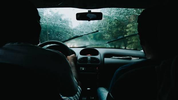 Two Men Inside Moving Vehicle Free Photo
