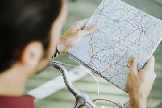 Man Holding Map Free Photo