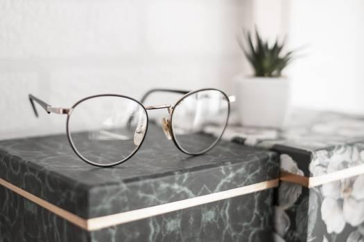 Gray-framed Eyeglasses on Black Surface Free Photo
