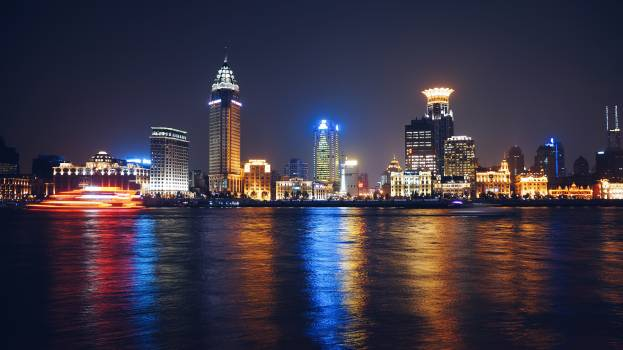 Lighted City Skyline Near Body of Water during Nighttime #34097