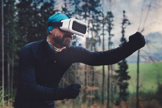 Person Wearing Black Henley Shirt and White Vr Goggles Free Photo