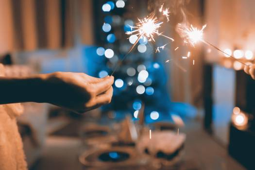 Close Up Photograph of Two Person Holding Sparklers #341159
