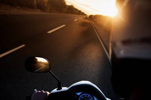 Person Riding on Motorcycle Free Photo