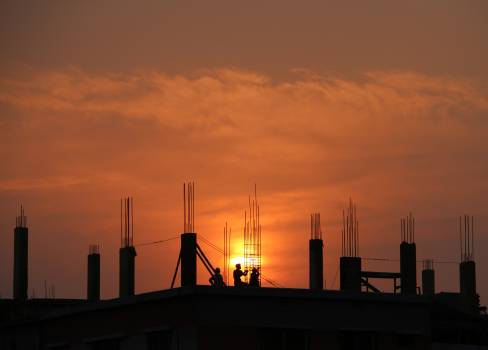 Silhouette of Men in Construction Site during Sunset #34133