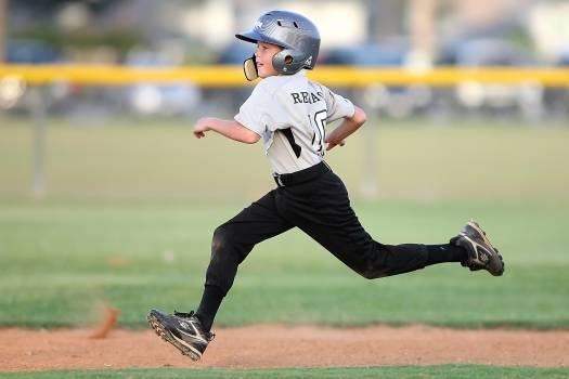Baseball Player in Gray and Black Uniform Running Free Photo