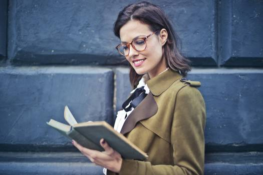 Woman In Brown Suede Peacoat Reading A Book Free Photo