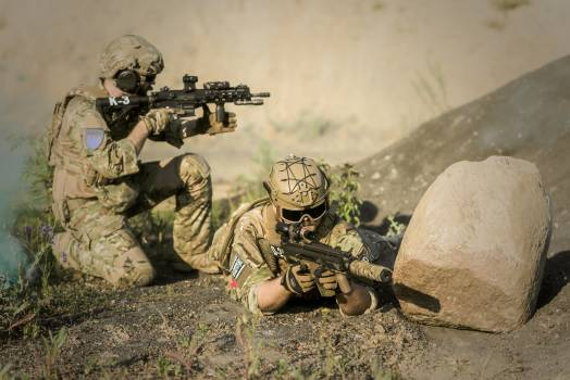 Military Sniping Near Rock Free Photo