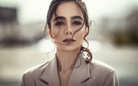 Selective Focus Portrait Photo of Woman in Beige Coat Posing #341725