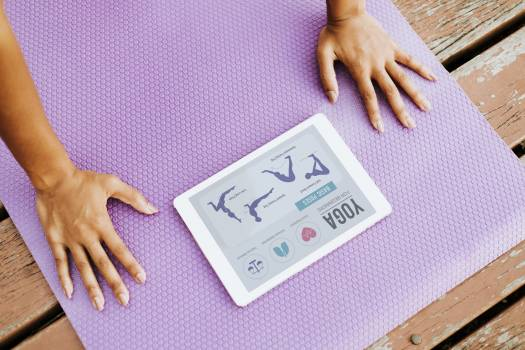 Person Doing Yoga While Looking at Silver Ipad Free Photo