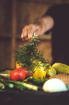 Person Putting Rosemary Into Vegetable Dish #341777