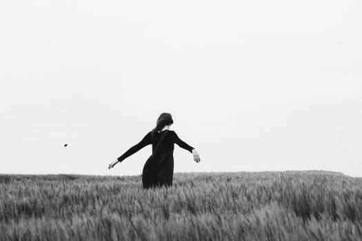 Woman Walking on the Grass Free Photo