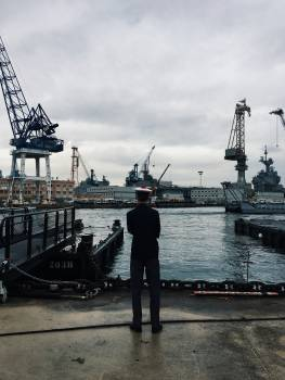 Man Standing and Facing Boats on Water Free Photo