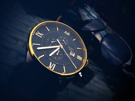Round Gold-color Chronograph Watch With Black Strap at 7:36 Free Photo