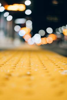 Close View of Pavement With Bokeh Light Background Free Photo
