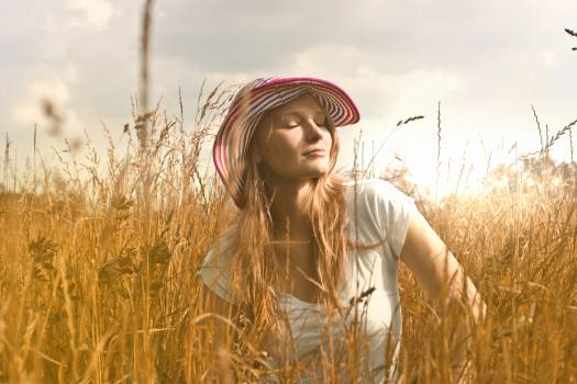 Woman Wearing White Top and Red and White Sunny Hat #342389