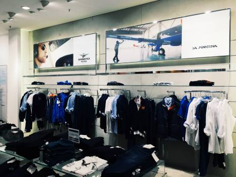 Clothes Hanging in Store Free Photo