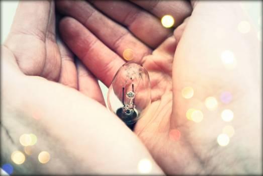 Centered Clear Bulb on Human Hand #34483