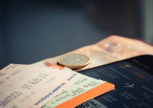 Orange and Green Label Airplane Ticket Free Photo