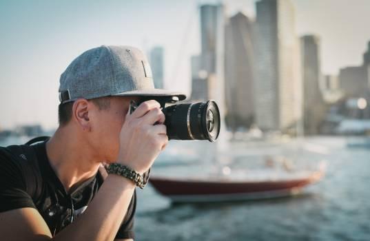 Man Wearing Gray Cap Taking Photograph Using Camera #34594
